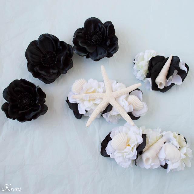 黒と白の花とヒトデ貝を使った結婚式用の髪飾り1