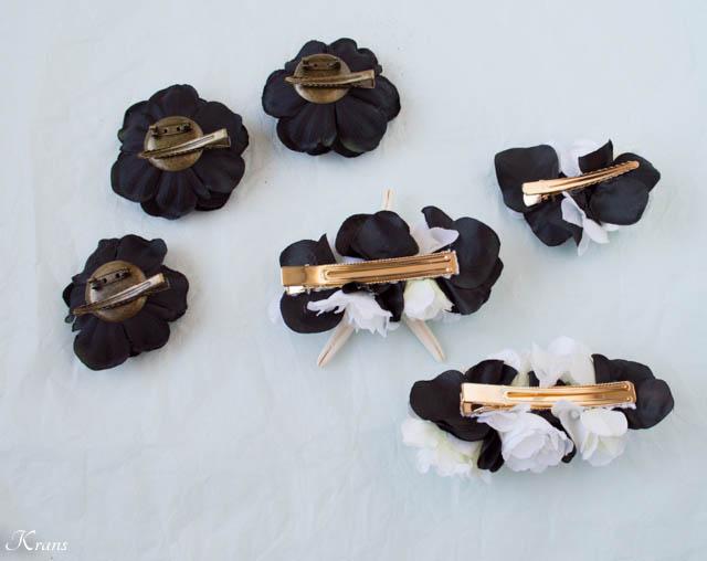 黒と白の花とヒトデ貝を使った結婚式用の髪かざりの後ろ側